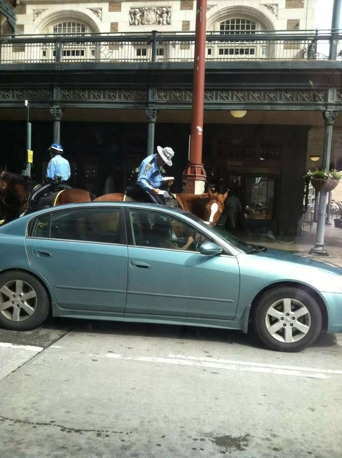 Seeing someone get a ticket from mounted patrol isn't weird. --Radioroula / Twitter Photo: Twitpic:radioroula