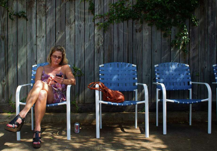 You're used to sticky skin on a humid day. --Deisy Enriquez / Houston Chronicle Photo: Cody Duty, Houston Chronicle / © 2011 Houston Chronicle