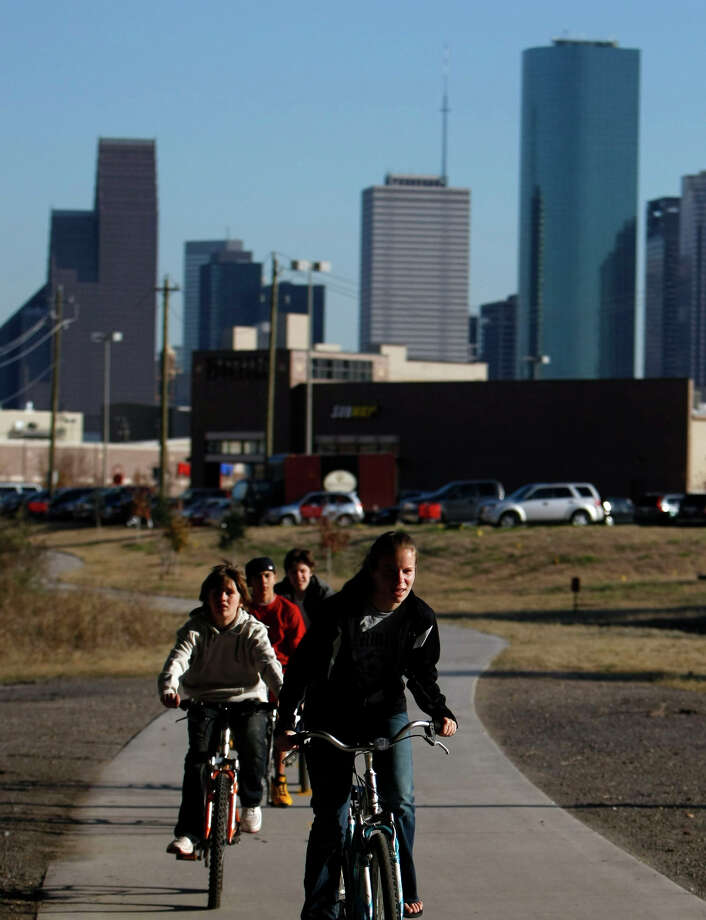 You stop referring to Houston as the fourth-largest city, instead you refer to as a big small town. -- Karen Warren / Houston Chronicle Photo: Johnny Hanson, Houston Chronicle / Houston Chronicle