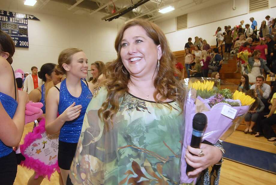 Dance director Darby Boyd accepts a bouquet after the Taylor High School Pacesetter Review.Dance director Darby Boyd accepts a bouquet after the Taylor High School Pacesetter Review. Photo: Â Tony Bullard 2013, Freelance Photographer / © Tony Bullard & the Houston Chronicle