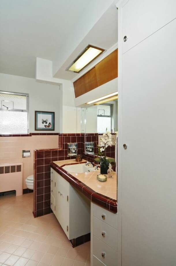 Bathroom of 5811 17th Ave. S. The 3,000-square-foot house, built in 1951, has three bedrooms, 1.75 bathrooms, a family room with a fireplace and bar, an unfinished basement and a covered patio on a 7,260-square-foot lot. It's listed for $349,900, although a sale is pending. Photo: Courtesy Susan Gilbert, Windermere Real Estate