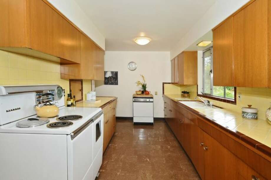 Kitchen of 5811 17th Ave. S. The 3,000-square-foot house, built in 1951, has three bedrooms, 1.75 bathrooms, a family room with a fireplace and bar, an unfinished basement and a covered patio on a 7,260-square-foot lot. It's listed for $349,900, although a sale is pending. Photo: Courtesy Susan Gilbert, Windermere Real Estate