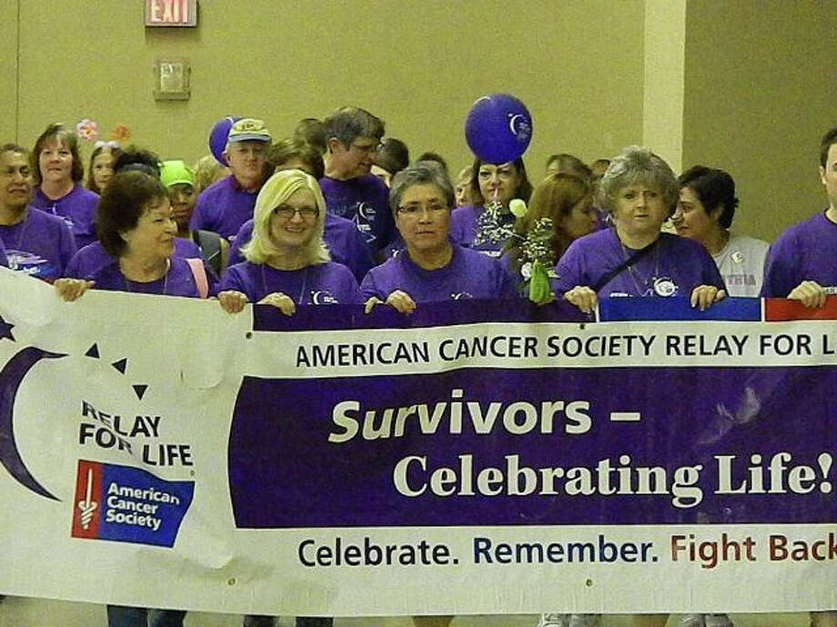 Donning purple T-shirts, more than 70 cancer survivors led the opening lap of Friday's annual Relay For Life event at Retama Park. Photo: Tamara Pearis / For The NE Heral