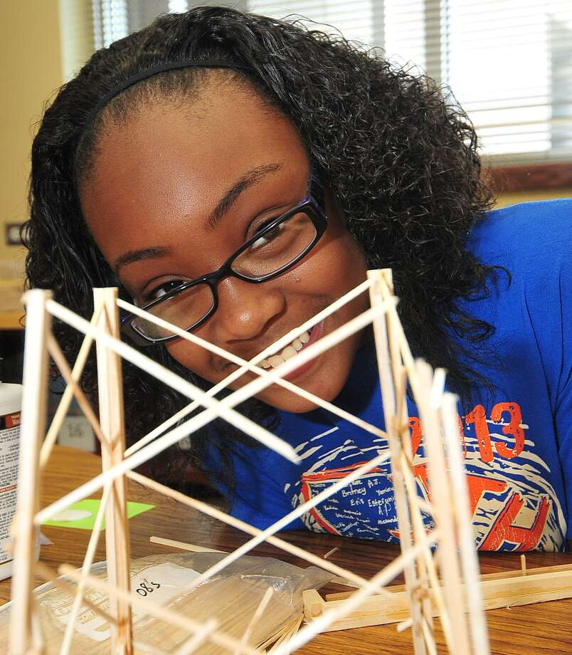 Kiera Stovall, 11, works on props made of balsa for Walnut Bend Elementary School's entry into the world competition of Odyssey of the Mind. Photo: Â Tony Bullard 2013, Freelance Photographer / © Tony Bullard & the Houston Chronicle