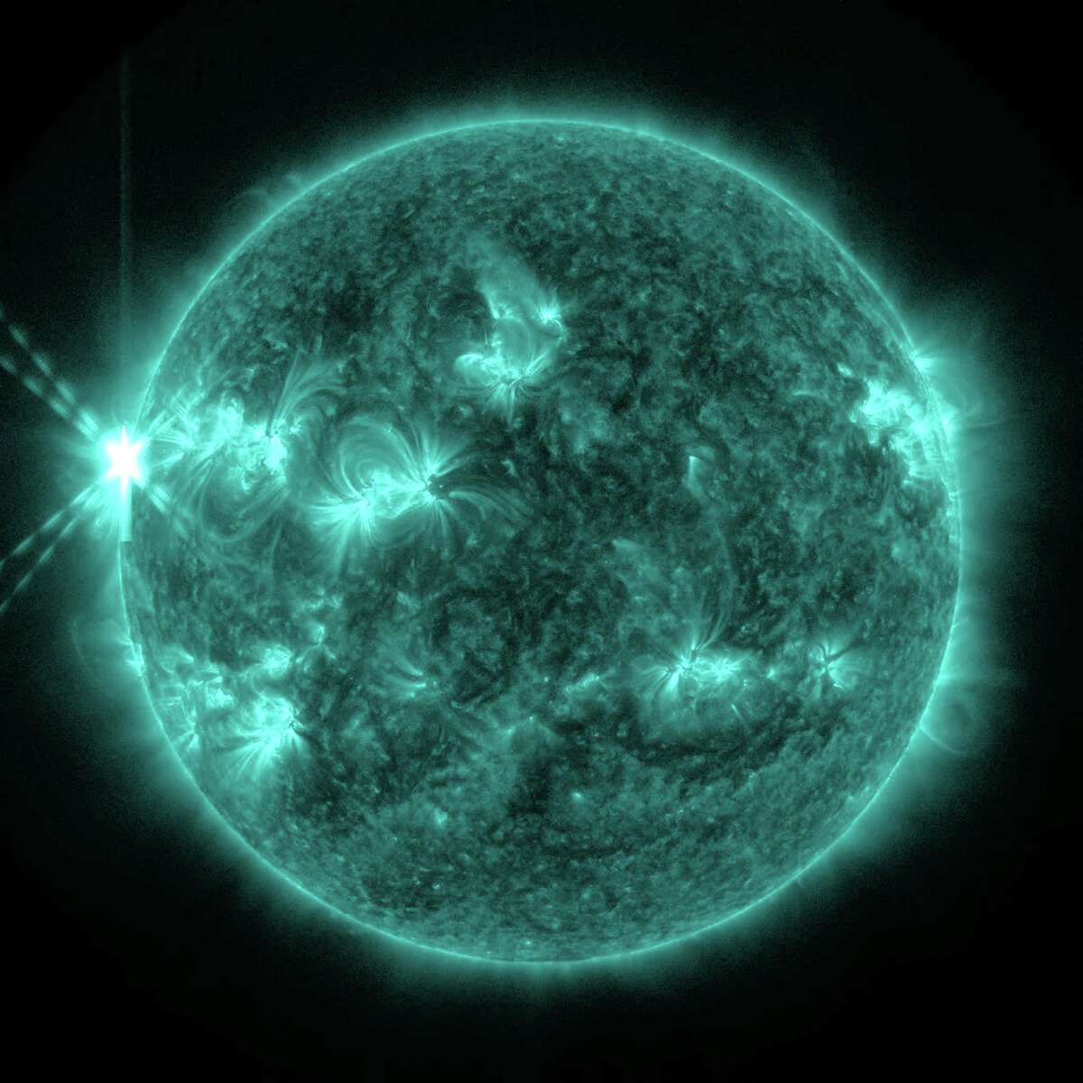 On May 13, 2013, an X2.8-class flare erupted from the sun -- the strongest flare of 2013 to date. This image of the flare, shown in the upper left corner, was captured by NASA's Solar Dynamics Observatory in light of 131 angstroms, a wavelength which is particularly good for capturing the intense heat of a solar flare and which is typically colorized in teal. Credit: NASA/SDO
