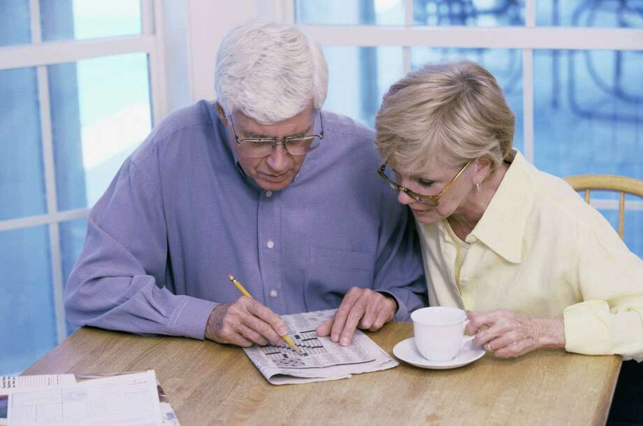 Brain games such as crossword puzzles can help delay memory loss. Photo: Ingram Publishing / Ingram Publishing