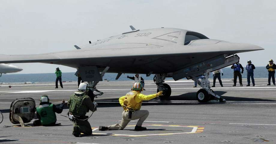 A Navy X-47B drone is launched off the nuclear powered aircraft carrier USS George H. W. Bush off the coast of Virginia, Tuesday, May 14, 2013. The plane isn't intended for operational use, but it will be used to help develop other unmanned, carrier-based aircraft. Photo: Steve Helber, Associated Press / AP