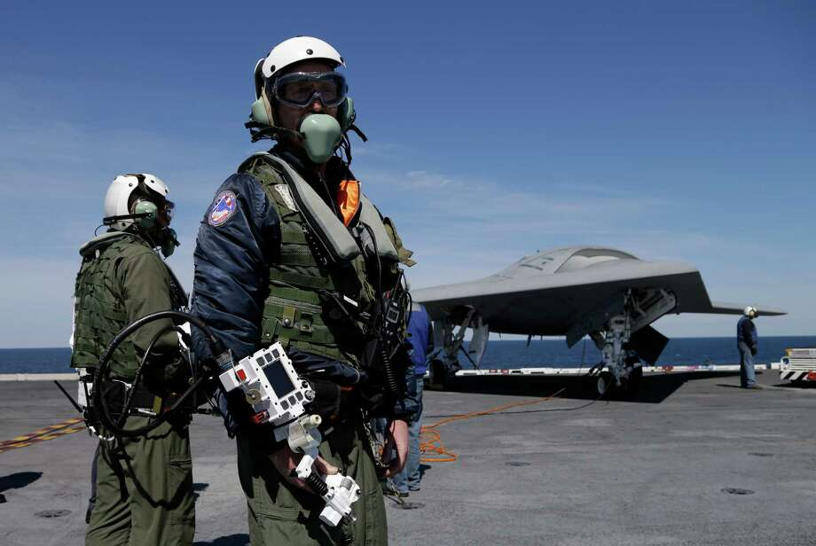 Northrop Grumman test pilots, Dave Lorenz, of Md., center, Md., and Bruce McFadden, left, of Md., prepare to taxi the Navy X-47B drone to be launched off the nuclear powered aircraft carrier USS George H. W. Bush off the coast of Virginia, Tuesday, May 14, 2013. Photo: Steve Helber, Associated Press / AP