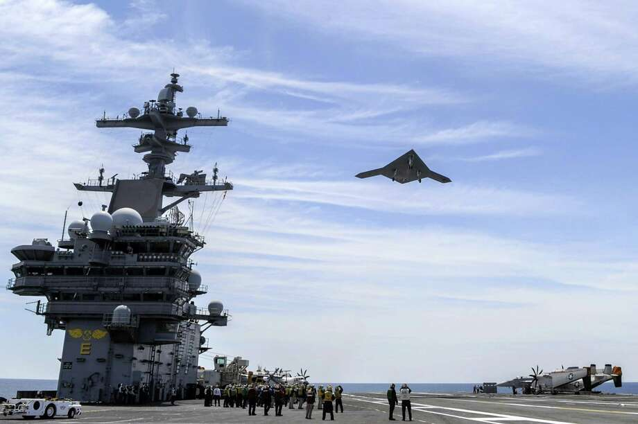 In this handout released by the U.S. Navy courtesy of Northrop Grumman, an X-47B Unmanned Combat Air System (UCAS) demonstrator flies over after launching from the aircraft carrier USS George H.W. Bush (CVN 77) May 14, 2013 in the Atlantic Ocean. George H.W. Bush is the first aircraft carrier to successfully catapult-launch an unmanned aircraft from its flight deck. The Navy plans to have unmanned aircraft on each of its carriers to be used for surveillance and be armed and used in combat roles. Photo: U.S. Navy, Getty Images / 2013 U.S. Navy