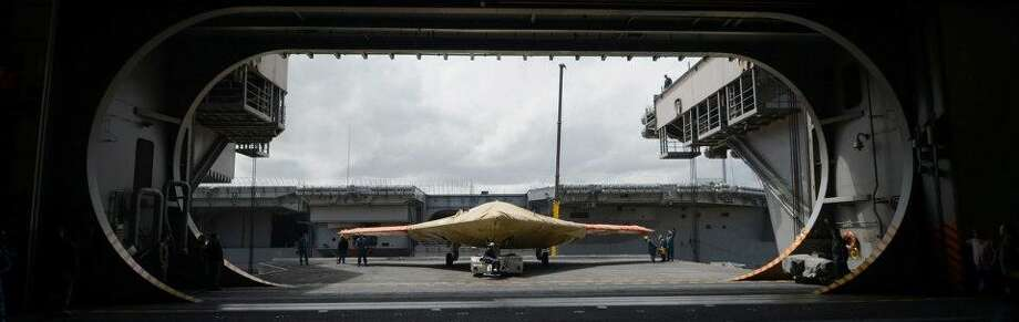 In this image provided by the U.S. Navy an X-47B Unmanned Combat Air System demonstrator sits on an aircraft elevator of the aircraft carrier USS George H.W. BushMonday May 6, 2013. The George H.W. Bush is scheduled to be the first aircraft carrier to catapult-launch an unmanned aircraft from its flight deck Tuesday May 14, 2013. Photo: Specialist 2nd Class Tony D. Cur, Associated Press / US Navy