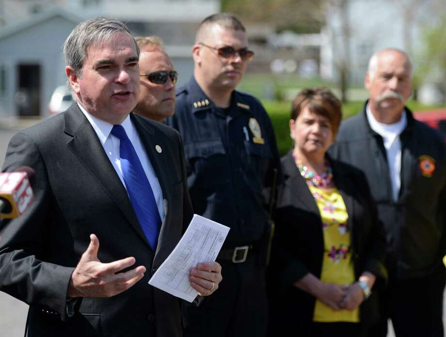 Mayor Gary McCarthy, left,  flanked by some of his department heads speaks about reducing the crime rate, the licensing of dogs in the City and  getting homes up to code May 14, 2013 in Schenectady, N.Y.   With McCarthy are Chief Code Inspector Eric Schilling, second from left,  Police Chief Brian Kilcullen, Councilwoman Leesa Perazzo and Fire Chief Mike DellaRocco.   (Skip Dickstein/Times Union) Photo: SKIP DICKSTEIN / 00022405A