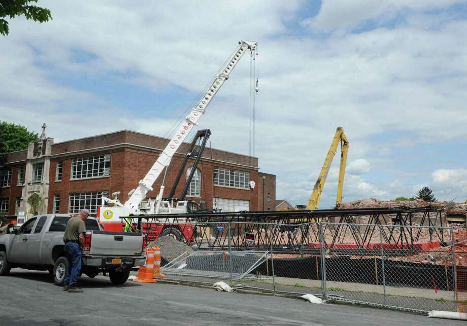 A large crane was delivered to take down the bell tower on St Patrick's Church on Tuesday, May 14, 2013 in Watervliet, N.Y. The crane still needs to be assembled and should be ready to use in a day or two. (Lori Van Buren / Times Union) Photo: Lori Van Buren / 00022327A