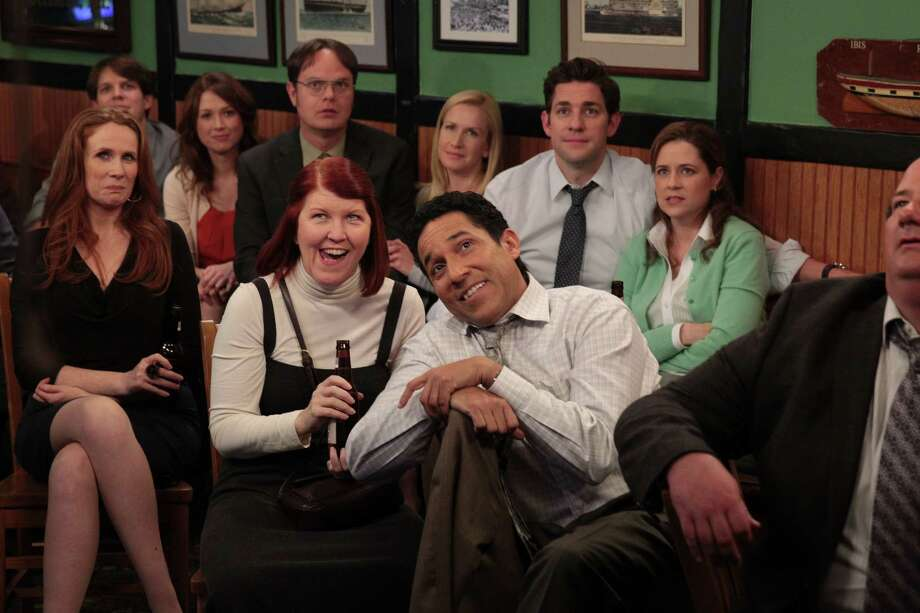 The cast (front row from left): Catherine Tate (Nellie), Kate Flannery (Meredith), Oscar Nuñez (Oscar); (back row from left) Jake Lacy (Pete), Ellie Kemper (Erin), Rainn Wilson (Dwight), Angela Kinsey (Angela), John Krasinski (Jim) and Jenna Fischer (Pam). Photo: Chris Haston / NBC
