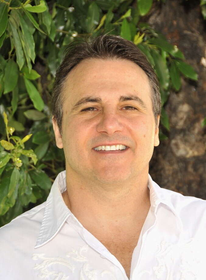 May 14, 2013: The main players in the Kings saga begin heading to Dallas, where the NBA's Board of Governors is slated to meet the next day. Kings owner George Maloof (pictured) reiterates that his family, which owns 65 percent of the franchise, remains committed to selling the team to the Seattle group. Meanwhile, Sacramento Mayor Kevin Johnson says he believes the Maloofs will consider Sacramento's counteroffer if the NBA rejects Chris Hansen's acquisition.  Photo: John M. Heller, Getty Images / 2011 John M. Heller