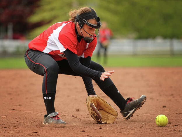 New Canaan third baseman Marlee Ready scoops up a ground ball during the second inning of their matchup with Ludlowe in Fairfield, Conn. on Monday, May 13, 2013. Photo: Brian A. Pounds / Connecticut Post