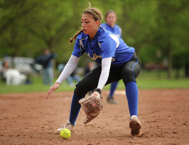 Ludlowe softball pitcher Eliza Guerrero fields the ball during the fifth inning of their game with New Canaan  Ludlowe High School  in Fairfield, Conn. on Monday, May 13, 2013. Photo: Brian A. Pounds / Connecticut Post