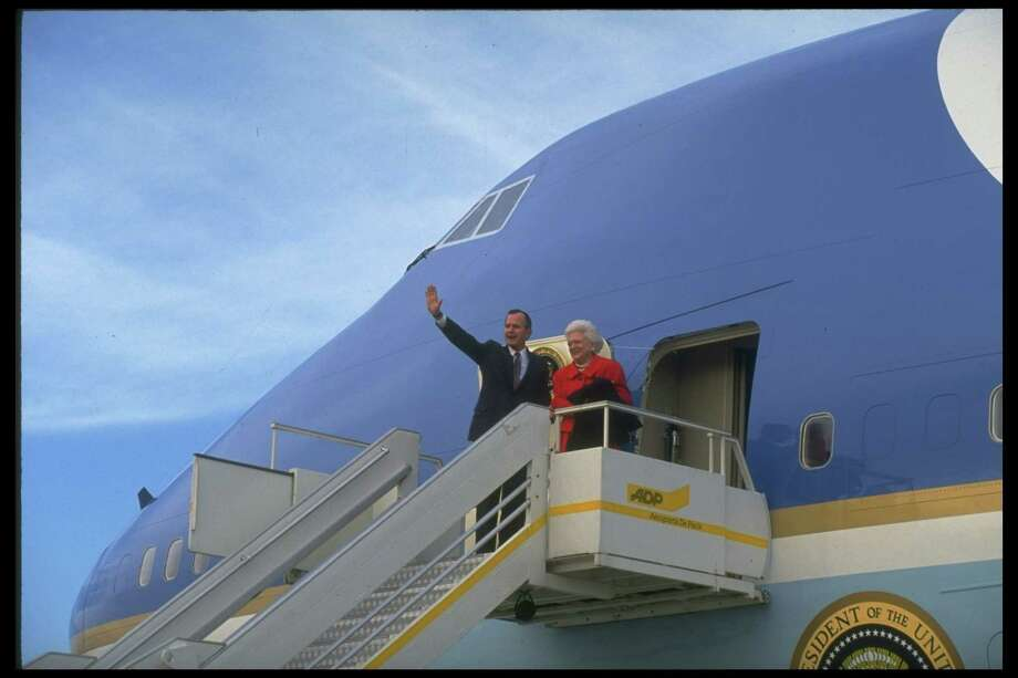 Pres. George H.W. Bush and First Lady Barbara Bush wave before boarding Air Force One in Paris, France on Nov. 1, 1990. Photo: Diana Walker, Time & Life Pictures/Getty Image / Diana Walker