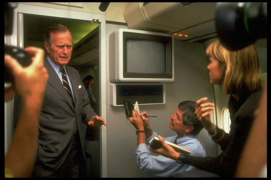 President George H.W. Bush chats with reporters aboard Air Force One on Aug. 6, 1991, en route to his home in Kennebunkport, Maine. Photo: Dirck Halstead, Time & Life Pictures/Getty Image / Dirck Halstead