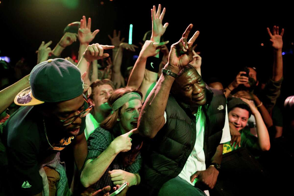 Shawn Kemp, center right, poses for pictures with an enthusiastic crowd during a Bring Our Sonics Back rally and concert Monday, May 13, 2013, at Neumos in Seattle. The free event featured such local hip hop artists as Geo, Grynch, Nacho Picasso and Dyme Def.