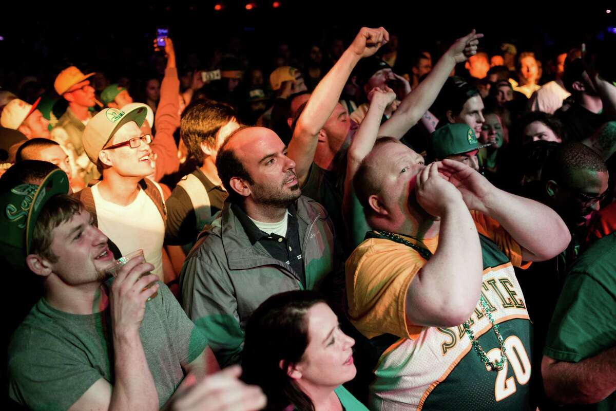 A packed house takes part in a call-and-response during a Bring Our Sonics Back rally and concert Monday, May 13, 2013, at Neumos in Seattle. The free event featured such local hip hop artists as Geo, Grynch, Nacho Picasso and Dyme Def.