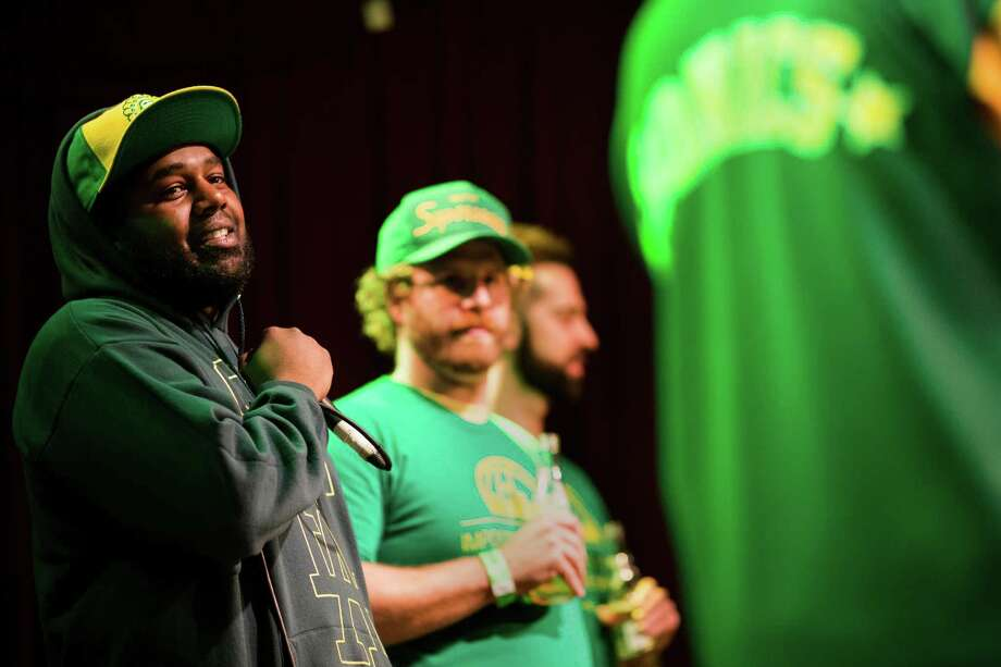 Event host Tilson, left, addresses the crowd during a Bring Our Sonics Back rally and concert Monday, May 13, 2013, at Neumos in Seattle. The free event featured such local hip hop artists as Geo, Grynch, Nacho Picasso and Dyme Def. Photo: JORDAN STEAD, SEATTLEPI.COM / SEATTLEPI.COM