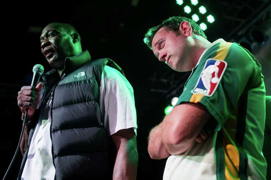Shawn Kemp, left, and Chris Cashman, right, talk to the crowd from the stage during a Bring Our Sonics Back rally and concert Monday, May 13, 2013, at Neumos in Seattle. The free event featured such local hip hop artists as Geo, Grynch, Nacho Picasso and Dyme Def. Photo: JORDAN STEAD, SEATTLEPI.COM / SEATTLEPI.COM
