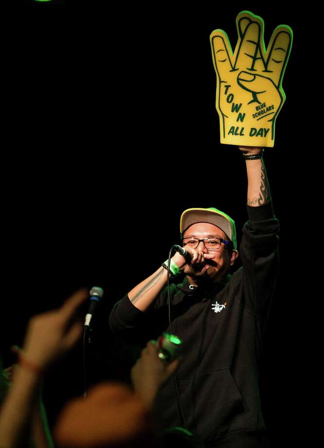 MC Geologic, also known as Geo of the Seattle-local hip-hop group Blue Scholars, calls for hands up from the crowd during a Bring Our Sonics Back rally and concert Monday, May 13, 2013, at Neumos in Seattle. The free event featured such local hip hop artists as Geo, Grynch, Nacho Picasso and Dyme Def. Photo: JORDAN STEAD, SEATTLEPI.COM / SEATTLEPI.COM