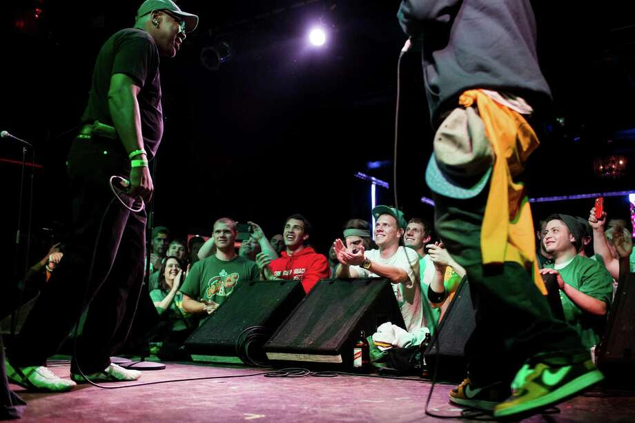 Wanz, left, takes part in a Bring Our Sonics Back rally and concert Monday, May 13, 2013, at Neumos in Seattle. The free event featured such local hip hop artists as Geo, Grynch, Nacho Picasso and Dyme Def. Photo: JORDAN STEAD, SEATTLEPI.COM / SEATTLEPI.COM