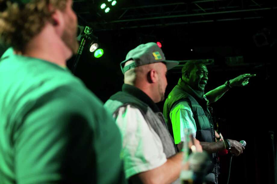 Shawn Kemp, right, addresses an enthusiastic crowd during a Bring Our Sonics Back rally and concert Monday, May 13, 2013, at Neumos in Seattle. The free event featured such local hip hop artists as Geo, Grynch, Nacho Picasso and Dyme Def. Photo: JORDAN STEAD, SEATTLEPI.COM / SEATTLEPI.COM