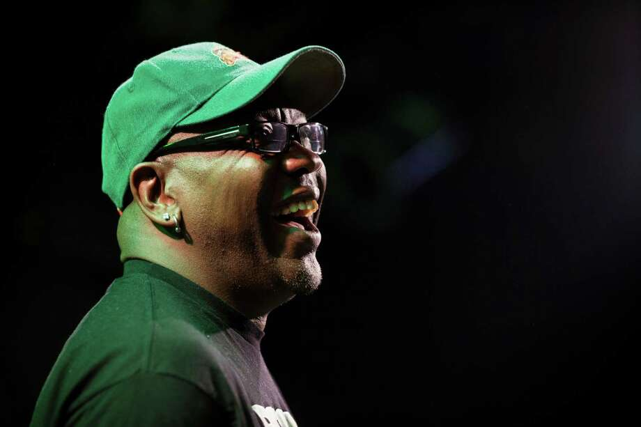 Wanz, left, laughs from the stage at a Bring Our Sonics Back rally and concert Monday, May 13, 2013, at Neumos in Seattle. The free event featured such local hip hop artists as Geo, Grynch, Nacho Picasso and Dyme Def. Photo: JORDAN STEAD, SEATTLEPI.COM / SEATTLEPI.COM
