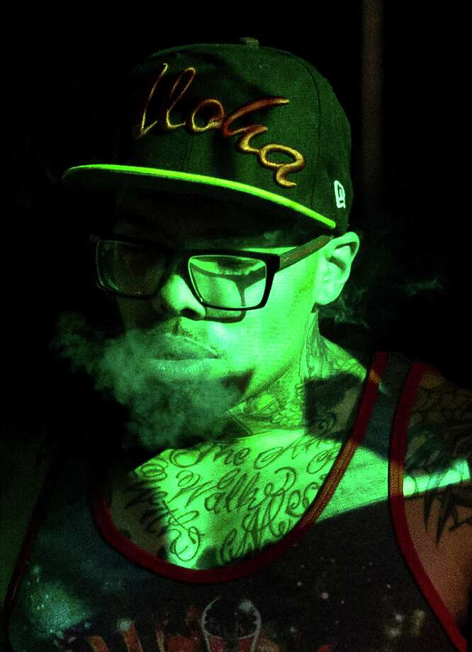 Rapper Nacho Picasso exhales smoke while taking to the stage to perform to a crowd during a Bring Our Sonics Back rally and concert Monday, May 13, 2013, at Neumos in Seattle. The free event featured such local hip hop artists as Geo, Nacho Picasso and Dyme Def. Photo: JORDAN STEAD, SEATTLEPI.COM / SEATTLEPI.COM