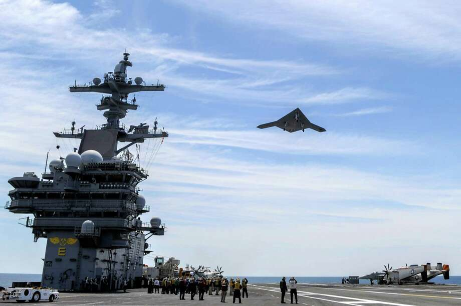 An X-47B Unmanned Combat Air System demonstrator flies over after launching from the aircraft carrier USS George H.W. Bush on May 14, 2013 in the Atlantic Ocean. Photo: U.S. Navy, Getty Images / 2013 U.S. Navy