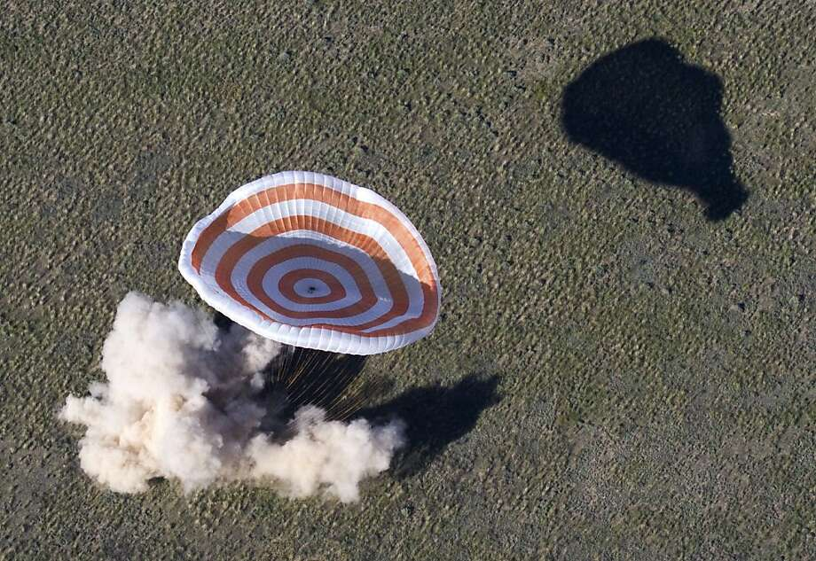 Back on Earth:The Russian Soyuz space capsule with U.S. astronaut Tom Marshburn, Canadian spaceman Chris 
