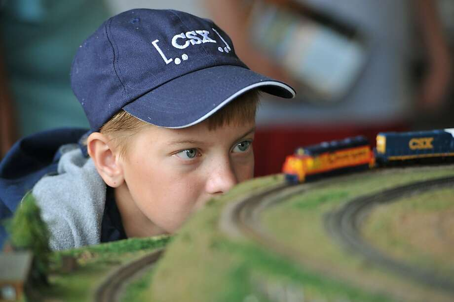 Plum loco:Twelve-year-old Curtis Web examines an N-gauge diesel engine pulling a freight train at the C&O Train Depot in Huntington, W.Va. Photo: Jamie Sabau, Getty Images For Amtrak
