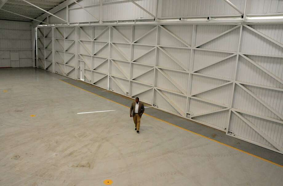 Manager Antonio Merritt walks through one of the renovated hangars at David Wayne Hooks Memorial Airport. Hooks is in the process of expanding and renovating parts of the airport in preparation for the Grand Parkway and Exxon Mobil. Photo: David Hopper, Freelance / freelance