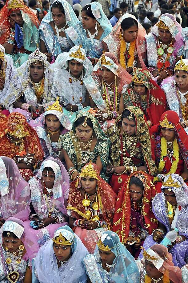 Indian brides waitto be married in a mass wedding on Akshaya Tritiya in Bhopal, India. The Hindu festival is considered most auspicious for marriages and buying gold, among other things. Photo: Rajeev Gupta, Associated Press