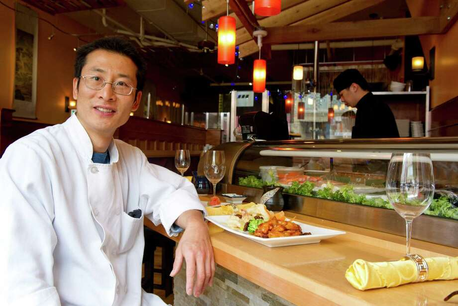 Chef and owner John Jiang poses for a photo at Shanghai Asian Bistro in Norwalk, Conn., on Tuesday, April 23, 2013. Photo: Lindsay Perry / Stamford Advocate