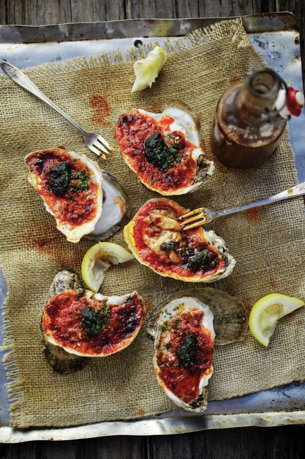 """Fire-Roasted Oysters from  """"Smoke: New Firewood Cooking"""" by Tim Byres (Rizzoli). Photo: Jody Horton"""