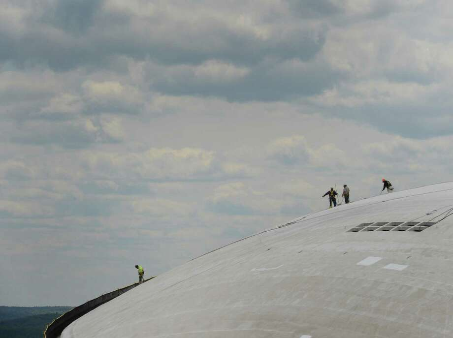 Workers clean and put a fresh coat of paint on the roof of the Egg on the Empire State Plaza on Tuesday, May 14, 2013, in Albany, N.Y.     (Skip Dickstein/Times Union) Photo: SKIP DICKSTEIN
