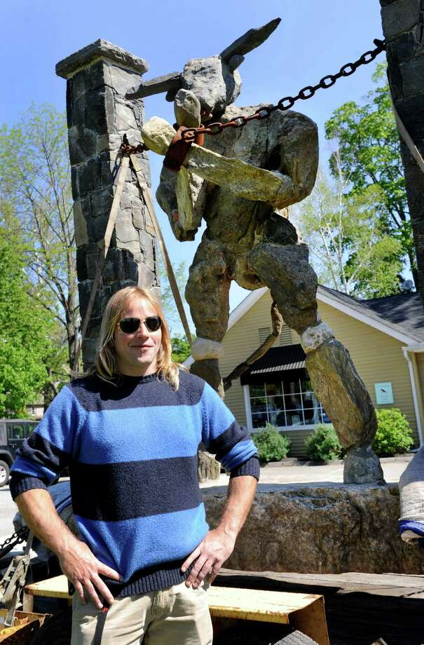 Sculptor Joseph Jaskolka, stands near his sculpture piece, Minotaur Bound, which is being removed from the Kent Green in Kent, Conn., Tuesday, May 14, 2013. Photo: Carol Kaliff / The News-Times