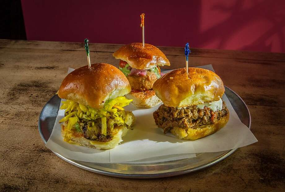 These Indian-style sliders called pavs ($13 for three) are the Vada Pav, Chowpatty Chicken Pav and the Holy Cow Pav at Juhu Beach Club in Oakland. Photo: John Storey