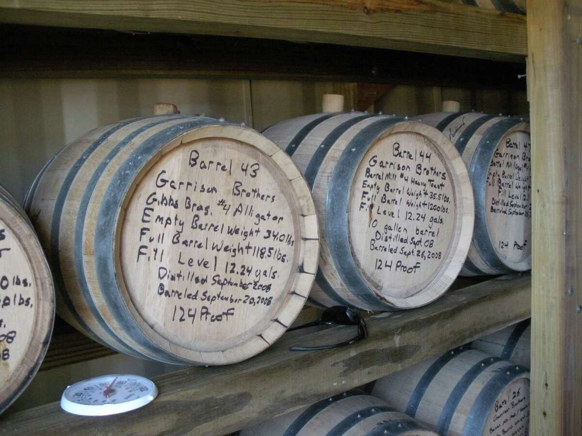 Bourbon - Barrels at Garrison Brothers Distillery in Hye, Texas show the date they were filled, the weight and the proof. Photo by John Griffin. Archiveplease.