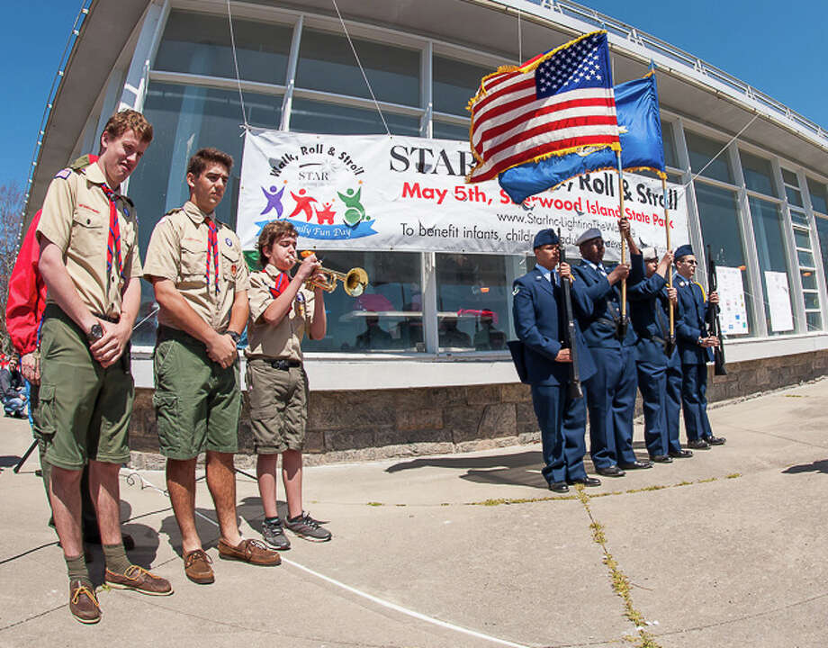 Members of Westport Boy Scout Troop 36, left, and a color guard from the Norwalk High School ROTC participated in opening cereemonies of the STAR Inc. walk at Sherwood Island State Park that the nonprofit said raised $90,000 for services to people with developmental disabilities in Mid-Fairfield County. Photo: Contributed Photo / Westport News