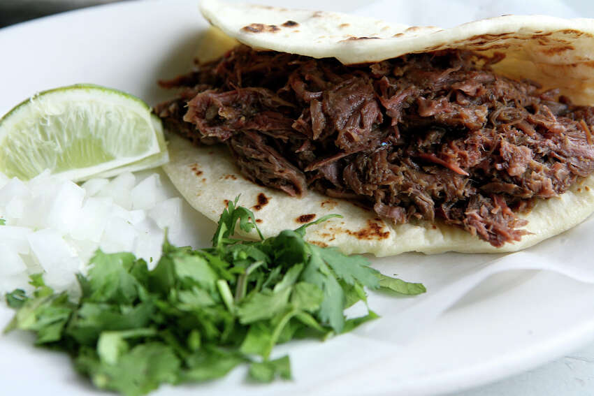 El Milagrito Cafe - Best Breakfast The eatery at 521 E. Woodlawn Ave. offers barbacoa breakfast tacos with cilantro and onions.