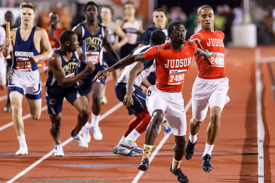 Judson's Jerome Gatewood takes the handoff from Brandon Sanders (far right) to start the anchor leg of the Class 5A 1,600-meter relay Saturday during the UIL state track meet at Mike Myers Stadium in Austin. Photo: Marvin Pfeiffer/ NE Herald