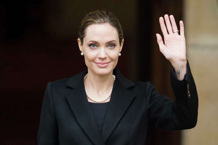 """(FILES) April 11, 2013 file photo shows US actress and humanitarian campaigner Angelina Jolie leaving Lancaster House in central London after speaking during an announcement of funding to address conflict sexual violence on the sidelines of the G8 Foreign Ministers meeting.  Angelina Jolie revealed May 14, 2013 that she has undergone a preventive double mastectomy to reduce her risk of cancer.  The American actress wrote in an opinion piece entitled """"My Medical Choice"""" in The New York Times that she had chosen the procedure because she carries a faulty gene that increases her risk of breast and ovarian cancer.   AFP PHOTO / LEON NEAL / FILESLEON NEAL/AFP/Getty Images Photo: LEON NEAL, Staff / AFP ImageForum"""