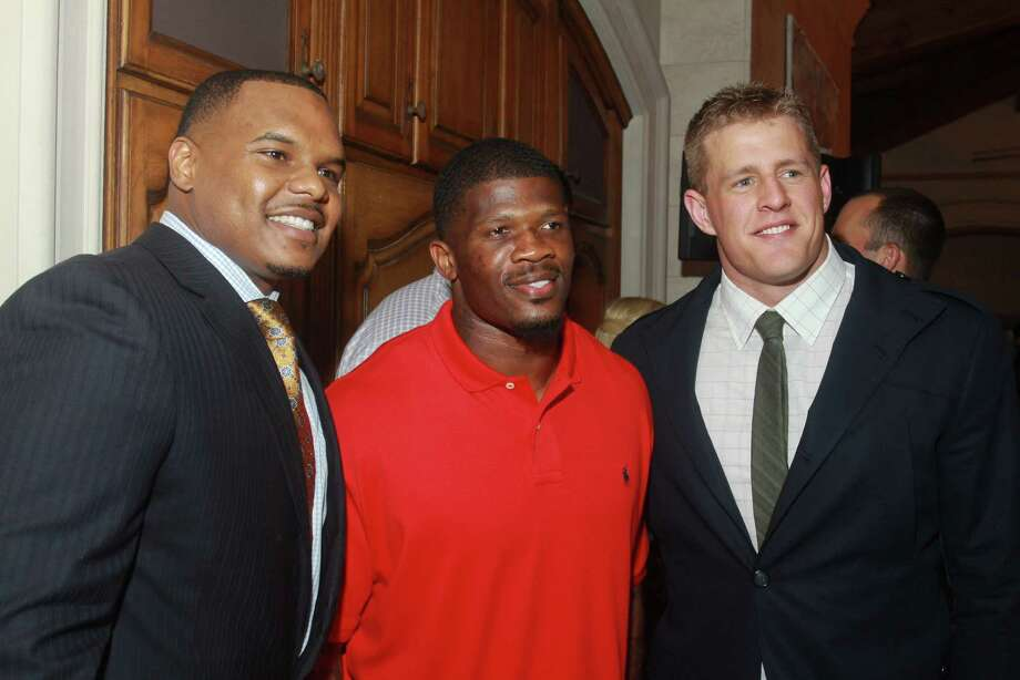 Chester Pitts, from left, Andre Johnson and J.J. Watt Photo: Gary Fountain, Freelance / Copyright 2013 Gary Fountain