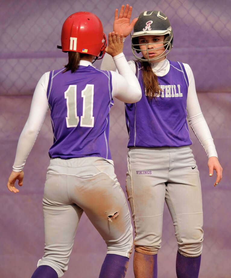 Westhill's Kate Brainard, left, and Morgan Kurtz celebrate both scoring against New Canaan at Westhill High School on Tuesday, May 14, 2013. Westhill won, 4-3. Photo: Jason Rearick / Stamford Advocate