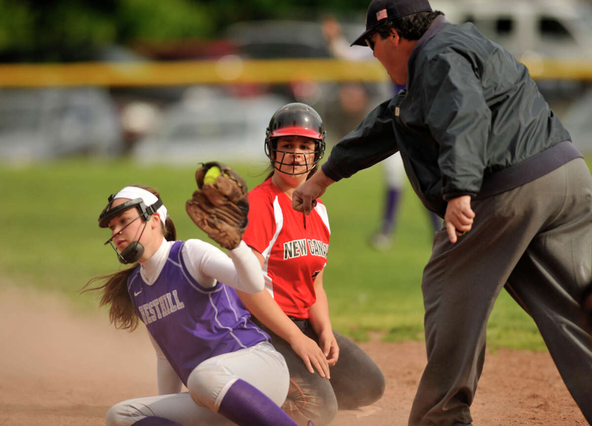 New Canaan's Amanda Frattaroli reacts to being tagged out as second by Westhill shortstop Morgan Kurtz during their game at Westhill High School on Tuesday, May 14, 2013. Westhill won, 4-3.