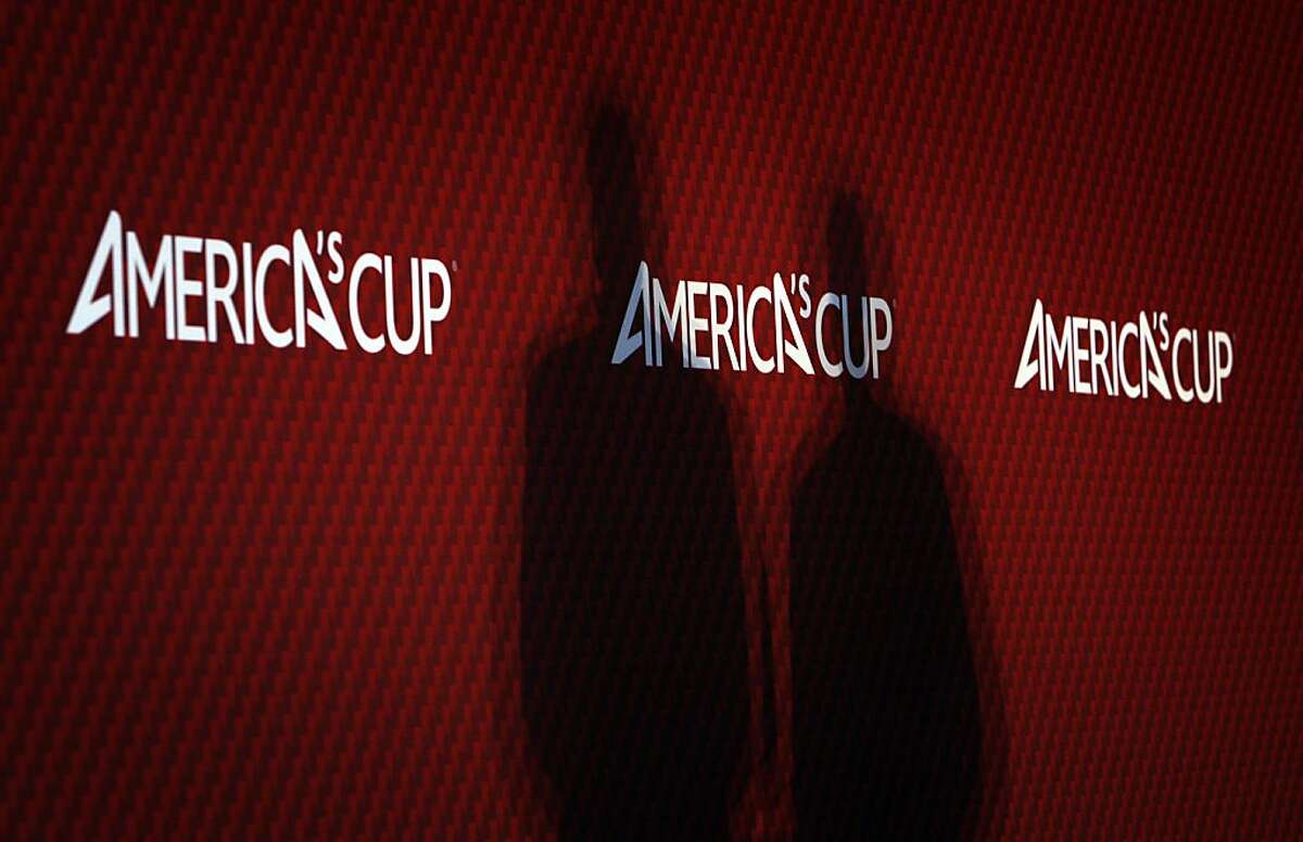 The shadows of Iain Murray, America's Cup Regatta Director, left, and Tom Ehman, Vice Commodore of the Golden Gate Yacht Club, are seen on the wall as the men address the media in San Francisco, Calif., on Tuesday, May 14, 2013, after a review committee was appointed following the death of Artemis crew member Andrew Simpson on May 9th.
